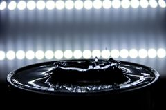 Water splashing and ripple occurs with backlight.  royalty free stock photo