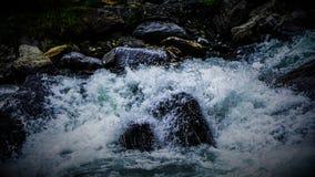 Water splashing on rocks Royalty Free Stock Image