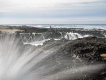 Water splashing at rugged coast line Royalty Free Stock Photos