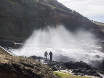 Water splashing at rugged coast line Royalty Free Stock Photography