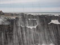 Water splashing at rugged coast line Royalty Free Stock Images