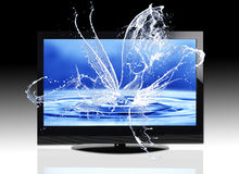 Water splashing from a screen. Water splashing out of a flat screen television monitor