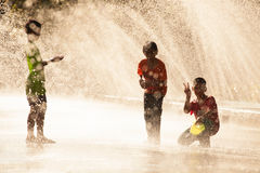Water Splashing in Songkran Festival. The horizontal image of people / children enjoying water splashing in the artificial water tunnel during Songkran Festival stock images
