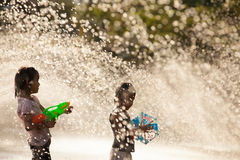 Water Splashing in Songkran Festival. The horizontal image of people / children enjoying water splashing in the artificial water tunnel during Songkran Festival Royalty Free Stock Image