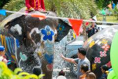 Water Splashing or Songkran Festival in Thailand. AYUTTHAYA, THAILAND - APR 13:  Revelers and elephants join in water splashing during Songkran Festival on Apr Royalty Free Stock Images