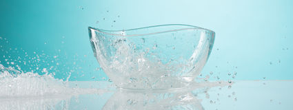 The water splashing to glass bowl on white background Stock Photo