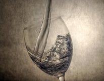 Water Splashing in Vine Glass Stock Photo
