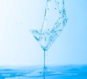 Water Splashing in a Wineglass Stock Image