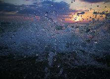 Water splatter. Sunset of the sea Royalty Free Stock Image
