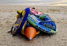 Water sport equipment on the beach. Colorful water sport equipment lying on the beach at the end of a happy day Royalty Free Stock Photo