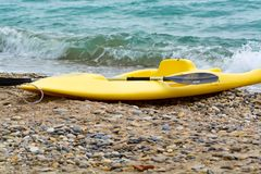 Water sport equipment - kayak on the beach, nobody. Water sport equipment - kayak on the beach, vacation leisure Royalty Free Stock Photos