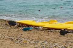 Water sport equipment - kayak on the beach, nobody. Water sport equipment - kayak on the beach, vacation leisure Stock Images