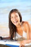 Water sport fun - beach woman bodyboarding surfing Royalty Free Stock Photography