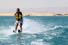 Water sports. Men make water ski in the beach in egypt Stock Photos