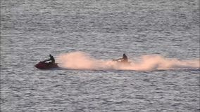 Water sports fun riding on jet skis. Video of holidaymakers enjoying water sports fun on whitstable coast riding powerful jet skis taken 25 june 2018 stock video footage
