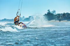 Water Sports. Kiteboarding, Kitesurfing. Surfer Surfing Waves. A. Water Sports. Kiteboarding, Kitesurfing. Surfer Man Surfing On Waves In Ocean, Sea. Extreme stock images