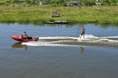 Water sports in summer water skiing on surfboard. Netherlands, North Holland province, region West Friesland, city, fortified small town Enkhuizen: Landscape royalty free stock photo