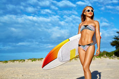 Water Sports. Surfing. Woman With Surfboard On Summer Holidays Vacations. Water Sports. Surfing. Healthy Happy Fit Surfer Woman, Girl In Bikini Having Fun With royalty free stock image