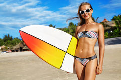 Water Sports. Surfing. Woman With Surfboard On Summer Holidays Vacations. Water Sports. Surfing. Healthy Happy Fit Surfer Woman, Girl In Bikini Having Fun With stock photos