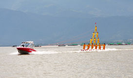 Water Sports - Water Skiing pyramid. Many water skiers water skiing in a pyramid shape on Lake Qionghai, Xichang, Sichuan Province,China Royalty Free Stock Photo