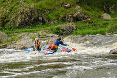 Water sportsmen move in threshold. Beklenischevo, Russia - June 12, 2005: The place with the Iset River rapid current, a so-called threshold the Revun - Howler Stock Images