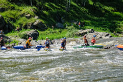 Water sportsmen move in threshold. Beklenischevo, Russia - June 12, 2005: The place with the Iset River rapid current, a so-called threshold the Revun - Howler Royalty Free Stock Photos