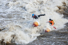 Water sportsmen in threshold. MOSCOW - APR 10: Unidentified sportsmen train in whitewater rafting techniques in Pakhra river during a traditional spring meeting royalty free stock photo