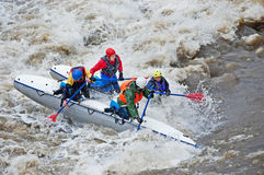 Water sportsmen in threshold. MOSCOW - APR 10: Unidentified sportsmen train in whitewater rafting techniques in Pakhra river during a traditional spring meeting stock photos