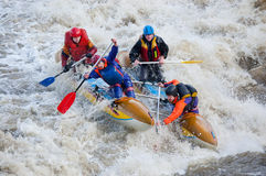Water sportsmen in threshold. MOSCOW - APR 10: Unidentified sportsmen train in whitewater rafting techniques in Pakhra river during a traditional spring meeting stock photography