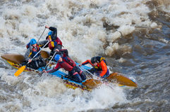 Water sportsmen in threshold. MOSCOW - APR 10: Unidentified sportsmen train in whitewater rafting techniques in Pakhra river during a traditional spring meeting royalty free stock photos