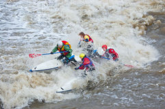 Water sportsmen in threshold. MOSCOW - APR 10: Unidentified sportsmen train in whitewater rafting techniques in Pakhra river during a traditional spring meeting Royalty Free Stock Photography
