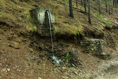 Free Water Spout On The Slope Of The Mountain Stock Photos - 135753853