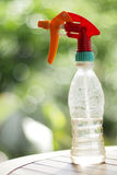 Water spray bottle. On the table with twinkle sunlights background Royalty Free Stock Photos