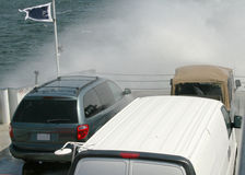 Water spray on cars on ferryboat. Water spray from a storm wave on cars on a ferryboat Royalty Free Stock Image
