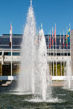 Water spray in fountain near business buildings Royalty Free Stock Photos
