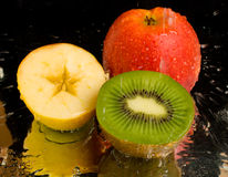 Water Spray On Kiwi And Apples Royalty Free Stock Photo