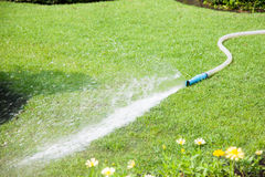 Water sprayed on lawns. Royalty Free Stock Images