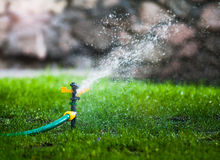 Water sprayer in the park Stock Photo