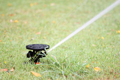 Water spread out from the Sprinkler of garden equipment Royalty Free Stock Photos