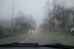 Bad Weather Driving - poor view caused by heavy rain and spray water, fog stock photography