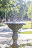 Water Spreading Everywhere. Near the road of the park with people resting and enjoying the sunlight Stock Photo