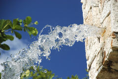 Water sprin flow Stock Photography