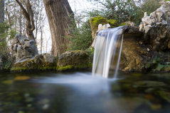 Water spring. A water spring with a small waterfall stock photo