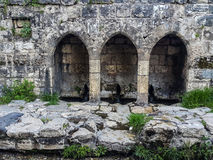 Water spring. Ancient stones water spring arches stock images