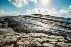 Water spring bursting from muddy volcanoes royalty free stock photography