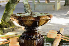 Water spring at temple`s garden, Kyoto Japan Royalty Free Stock Photos