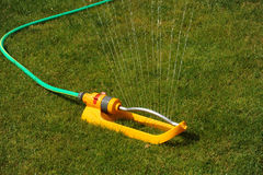 Water Sprinker. A water Sprinkler photographed on a garden lawn with water coming out Royalty Free Stock Photography