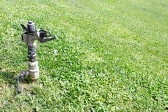 Water sprinkler Stock Images