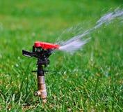 Water sprinkler 2. Garden lawn water sprinkler 2 Royalty Free Stock Images