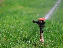 Water sprinkler 4. Garden lawn water sprinkler 4 Royalty Free Stock Photography